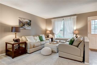 Photo 5: 65 COUGARSTONE Circle SW in Calgary: Cougar Ridge Detached for sale : MLS®# A1011643