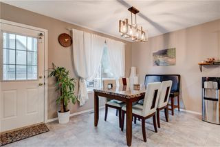 Photo 7: 65 COUGARSTONE Circle SW in Calgary: Cougar Ridge Detached for sale : MLS®# A1011643