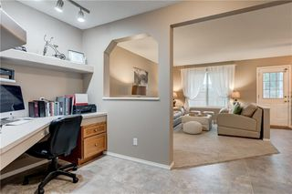 Photo 4: 65 COUGARSTONE Circle SW in Calgary: Cougar Ridge Detached for sale : MLS®# A1011643