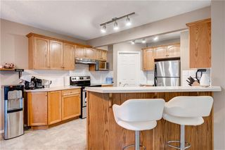 Photo 8: 65 COUGARSTONE Circle SW in Calgary: Cougar Ridge Detached for sale : MLS®# A1011643