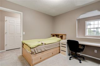 Photo 21: 65 COUGARSTONE Circle SW in Calgary: Cougar Ridge Detached for sale : MLS®# A1011643