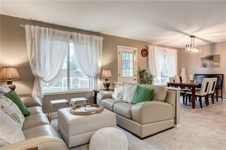 Photo 1: 65 COUGARSTONE Circle SW in Calgary: Cougar Ridge Detached for sale : MLS®# A1011643