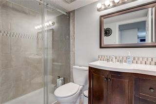 Photo 26: 65 COUGARSTONE Circle SW in Calgary: Cougar Ridge Detached for sale : MLS®# A1011643