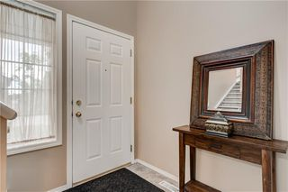 Photo 3: 65 COUGARSTONE Circle SW in Calgary: Cougar Ridge Detached for sale : MLS®# A1011643