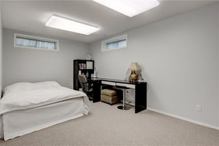 Photo 25: 65 COUGARSTONE Circle SW in Calgary: Cougar Ridge Detached for sale : MLS®# A1011643