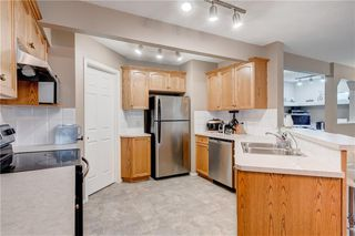 Photo 9: 65 COUGARSTONE Circle SW in Calgary: Cougar Ridge Detached for sale : MLS®# A1011643