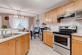 Photo 11: 65 COUGARSTONE Circle SW in Calgary: Cougar Ridge Detached for sale : MLS®# A1011643
