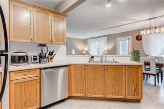 Photo 10: 65 COUGARSTONE Circle SW in Calgary: Cougar Ridge Detached for sale : MLS®# A1011643