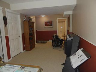 Photo 8: 76 CIMARRON Trail: Okotoks Townhouse for sale : MLS®# C3593967