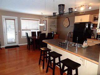 Photo 2: 76 CIMARRON Trail: Okotoks Townhouse for sale : MLS®# C3593967