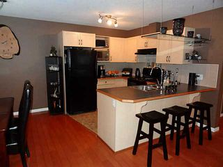 Photo 3: 76 CIMARRON Trail: Okotoks Townhouse for sale : MLS®# C3593967