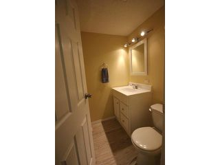 Photo 10: 53 123 QUEENSLAND Drive SE in CALGARY: Queensland Townhouse for sale (Calgary)  : MLS®# C3610862