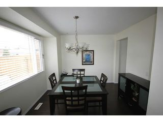 Photo 2: 53 123 QUEENSLAND Drive SE in CALGARY: Queensland Townhouse for sale (Calgary)  : MLS®# C3610862