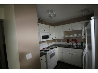 Photo 4: 53 123 QUEENSLAND Drive SE in CALGARY: Queensland Townhouse for sale (Calgary)  : MLS®# C3610862