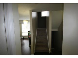 Photo 8: 53 123 QUEENSLAND Drive SE in CALGARY: Queensland Townhouse for sale (Calgary)  : MLS®# C3610862
