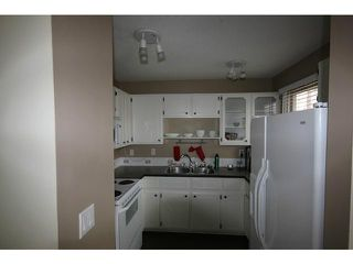 Photo 7: 53 123 QUEENSLAND Drive SE in CALGARY: Queensland Townhouse for sale (Calgary)  : MLS®# C3610862