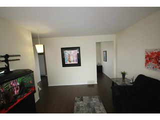 Photo 6: 53 123 QUEENSLAND Drive SE in CALGARY: Queensland Townhouse for sale (Calgary)  : MLS®# C3610862