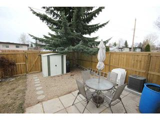 Photo 17: 53 123 QUEENSLAND Drive SE in CALGARY: Queensland Townhouse for sale (Calgary)  : MLS®# C3610862