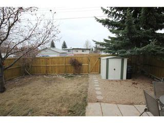 Photo 15: 53 123 QUEENSLAND Drive SE in CALGARY: Queensland Townhouse for sale (Calgary)  : MLS®# C3610862