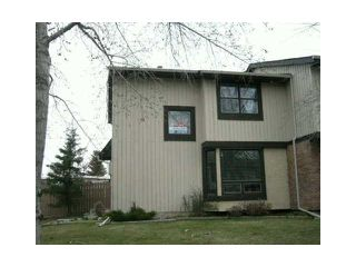 Photo 1: 53 123 QUEENSLAND Drive SE in CALGARY: Queensland Townhouse for sale (Calgary)  : MLS®# C3610862
