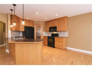 Photo 3: 30 CRYSTAL SHORES Place: Okotoks House for sale : MLS®# C3647168