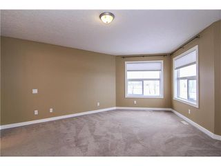 Photo 12: 30 CRYSTAL SHORES Place: Okotoks House for sale : MLS®# C3647168