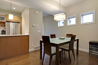 Photo 3: 2 36 Street SW in Calgary: Duplex for sale : MLS®# C3641142