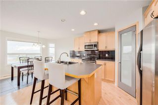 Photo 5: 354 PANAMOUNT BV NW in Calgary: Panorama Hills House for sale : MLS®# C4137770