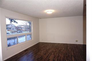 Photo 3: 95 ERIN WOODS Boulevard SE in Calgary: Erin Woods House for sale : MLS®# C4164400