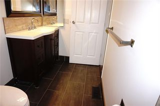 Photo 13: 95 ERIN WOODS Boulevard SE in Calgary: Erin Woods House for sale : MLS®# C4164400