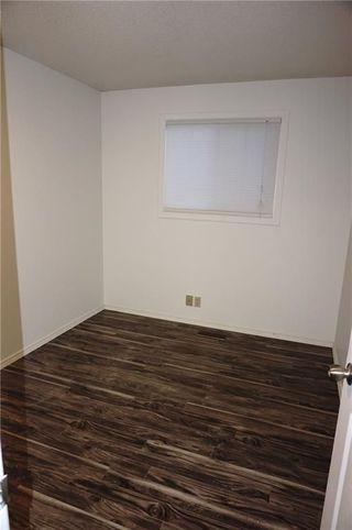 Photo 19: 95 ERIN WOODS Boulevard SE in Calgary: Erin Woods House for sale : MLS®# C4164400