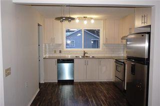 Photo 9: 95 ERIN WOODS Boulevard SE in Calgary: Erin Woods House for sale : MLS®# C4164400