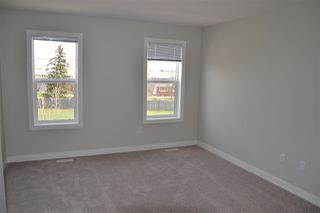 Photo 18: 219 GRIESBACH Road in Edmonton: Zone 27 House Half Duplex for sale : MLS®# E4142357