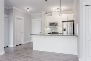 "Photo 2: 408 2229 ATKINS Avenue in Port Coquitlam: Central Pt Coquitlam Condo for sale in ""Downtown Pointe"" : MLS®# R2427383"