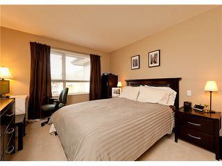 "Photo 3: 411 600 KLAHANIE Drive in Port Moody: Port Moody Centre Condo for sale in ""BOARDWALK"" : MLS®# V919334"