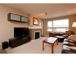 "Photo 2: 411 600 KLAHANIE Drive in Port Moody: Port Moody Centre Condo for sale in ""BOARDWALK"" : MLS®# V919334"