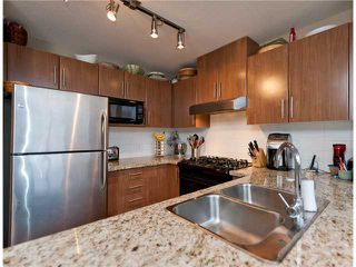 "Photo 1: 411 600 KLAHANIE Drive in Port Moody: Port Moody Centre Condo for sale in ""BOARDWALK"" : MLS®# V919334"