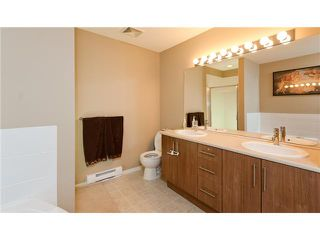 "Photo 5: 411 600 KLAHANIE Drive in Port Moody: Port Moody Centre Condo for sale in ""BOARDWALK"" : MLS®# V919334"