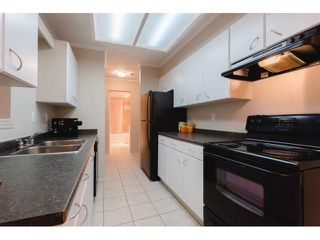 "Photo 11: 408 9672 134 Street in Surrey: Whalley Condo for sale in ""DOGWOOD/PARKWOOD"" (North Surrey)  : MLS®# F1439717"