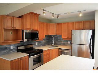 "Photo 3: 404 1432 PARKWAY Boulevard in Coquitlam: Westwood Plateau Condo for sale in ""Ironwood- Montreux"" : MLS®# V1135534"