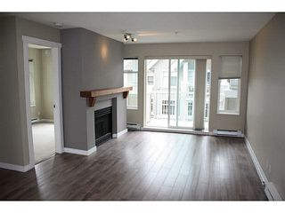"Photo 6: 404 1432 PARKWAY Boulevard in Coquitlam: Westwood Plateau Condo for sale in ""Ironwood- Montreux"" : MLS®# V1135534"