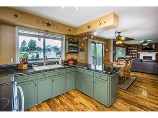"Photo 11: 10448 GLASGOW Street in Chilliwack: Fairfield Island House for sale in ""FAIRFIELD ISLAND"" : MLS®# R2090504"