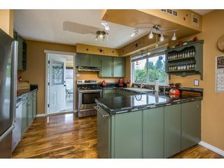 "Photo 9: 10448 GLASGOW Street in Chilliwack: Fairfield Island House for sale in ""FAIRFIELD ISLAND"" : MLS®# R2090504"
