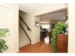 Photo 3: 1857 BAYWATER Street SW: Airdrie House for sale : MLS®# C4104542