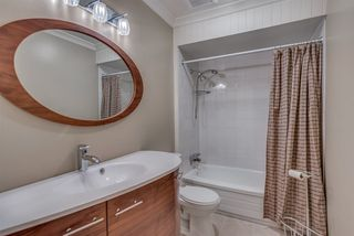 """Photo 17: 1119 HERITAGE Boulevard in North Vancouver: Seymour NV Townhouse for sale in """"HERITAGE IN THE WOODS"""" : MLS®# R2210880"""