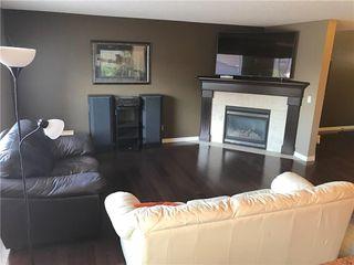 Photo 2: 821 AUBURN BAY BV SE in Calgary: Auburn Bay House for sale : MLS®# C4125470