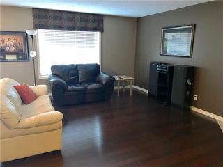 Photo 3: 821 AUBURN BAY BV SE in Calgary: Auburn Bay House for sale : MLS®# C4125470
