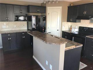 Photo 5: 821 AUBURN BAY BV SE in Calgary: Auburn Bay House for sale : MLS®# C4125470