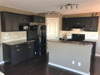 Photo 4: 821 AUBURN BAY BV SE in Calgary: Auburn Bay House for sale : MLS®# C4125470