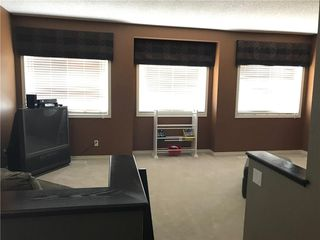 Photo 11: 821 AUBURN BAY BV SE in Calgary: Auburn Bay House for sale : MLS®# C4125470